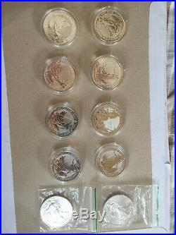 10 coins. 8x 1oz Solid Silver 2019 Britannia Coins and 2 silver American eagle