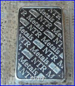 10oz. 999 Fine Solid Silver Bar. In Factory Sealed plastic pouch Q