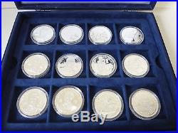 24 x solid silver Motorsport coins 682 grams. 999 pure all COA circa 1990's