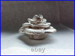 Hand poured 93/94 grams, 4 piece. 999 solid silver Flower
