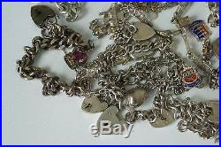 (ref165BO) 365g of assorted vintage solid silver charms and charm bracelets